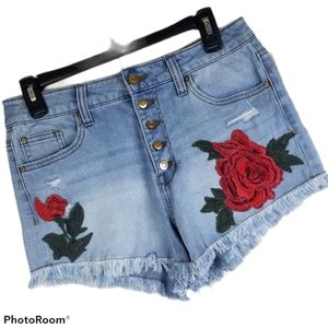 No Boundaries distressed button fly jean shorts